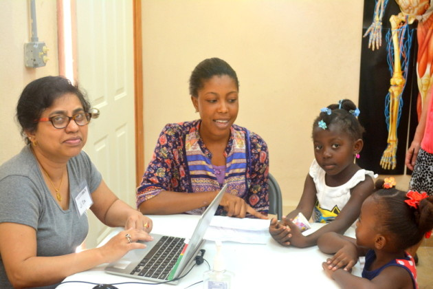 Madona translates for Animita and her little patients.