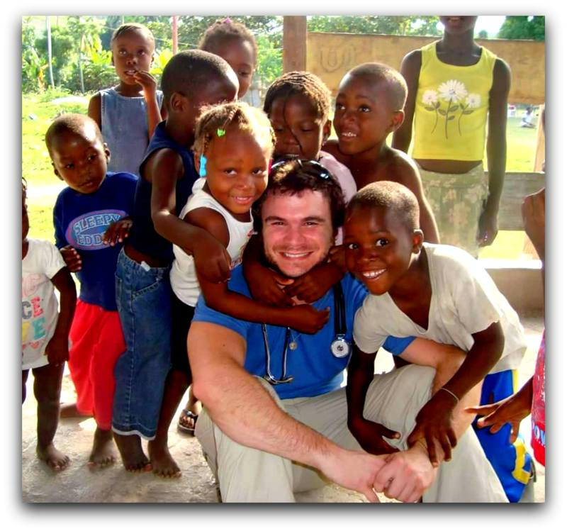 Brian Tangney, Jr. serving in Haiti.  My how the kids loved him!