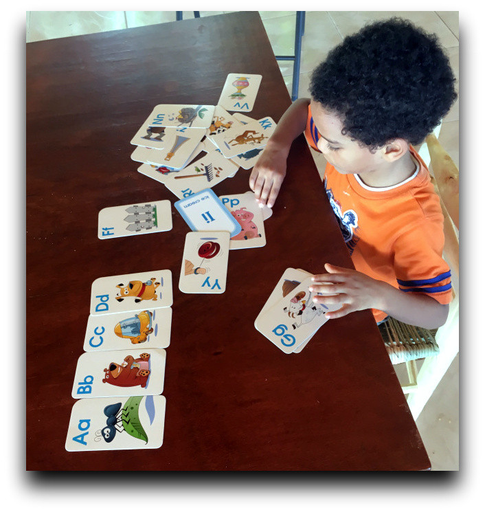 Caleb working on letter recognition