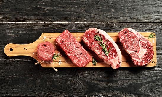 Fresh raw Prime Black Angus beef steaks