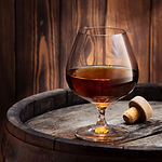 brandy or cognac in snifter glass on old