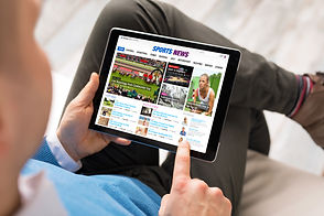 Man reading sports news on tablet. All c