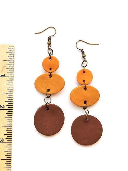 brown geometric statement earrings