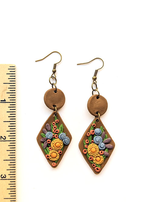 intricate floral brown earrings
