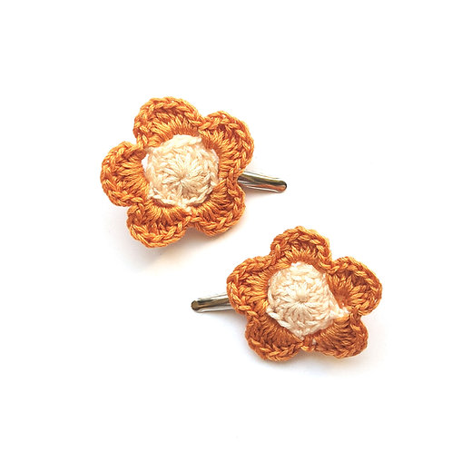 flower hair clips with orange petals