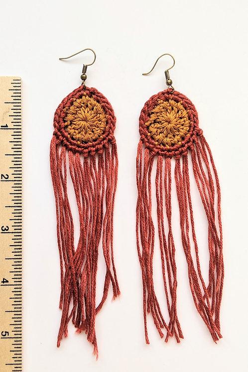 red and burnt orange tassel earrings