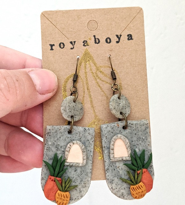 handmade polymer clay earrings that look like stone with a window and two potted succulents.