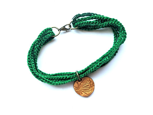 green lariat bracelet with butterfly charm