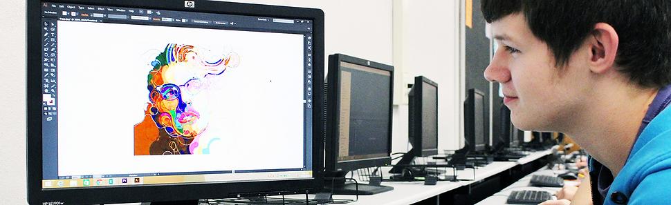 Student using Adobe Illustrator