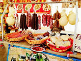 Visiting outdoor markets for local cheese and meats in Tuscany Italy