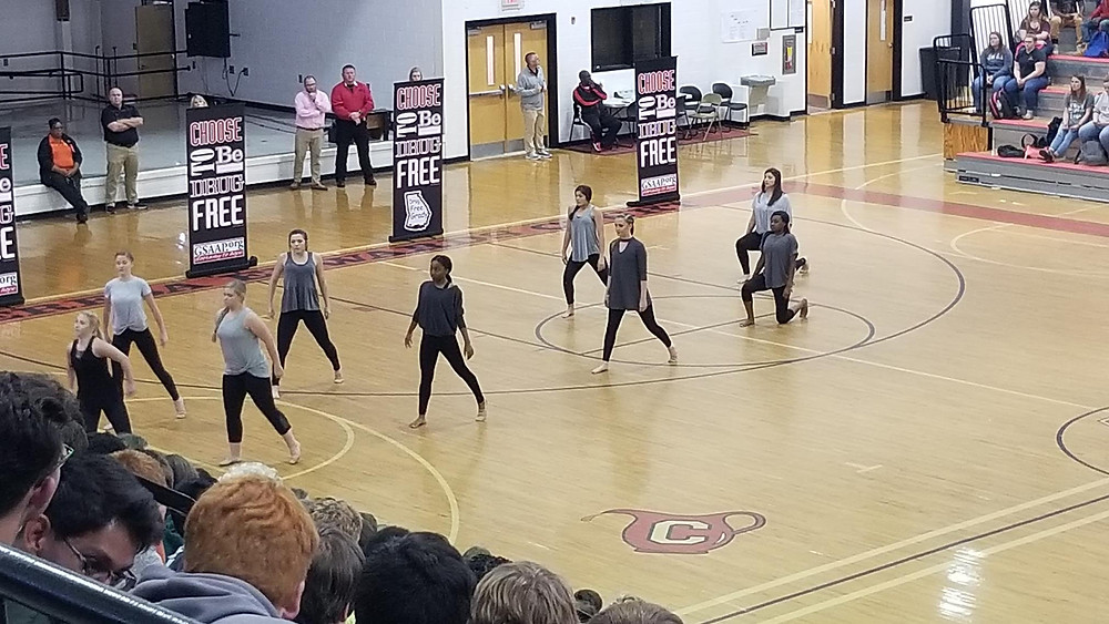(Front row, left to right) Madison Nelson, Kaitlyn Donalson, Iris Brimm, Madison Davie, and Yasmyn Hopkins (Back row, left to right) Isabelle Pomeroy, KT Morgan, Emmarie Lynn, and McKenzie Odum perform as members of the Firm.