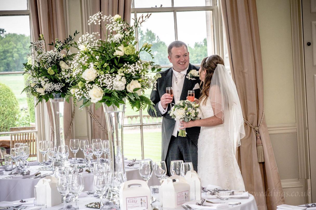 Bride & Groom with Table Arrangment.jpg