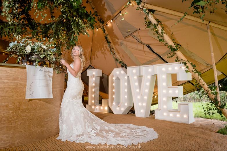 Model at Bar LOVE letters.jpg