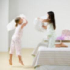 two children having pillow fight