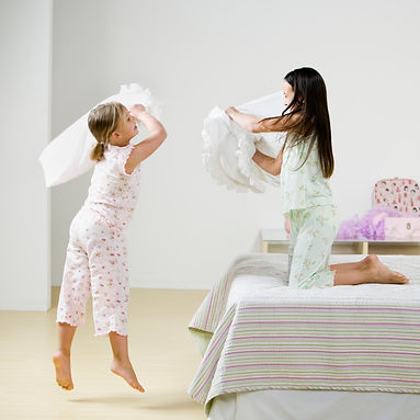 two children having pillow fight