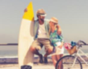 Man Woman Surfboard bike beach
