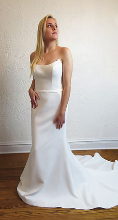 Style Amber wedding gown, strapless sheath gown matte satin with narrow belt, self buttons with rhinestone accent