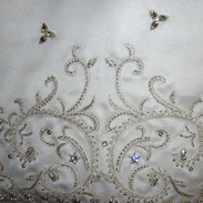 Custom designed embroidery and beading