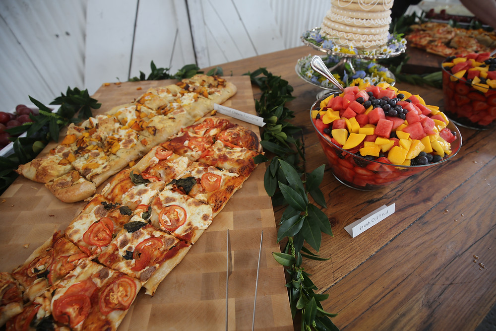 foccacia pizza and fruit bowls on table