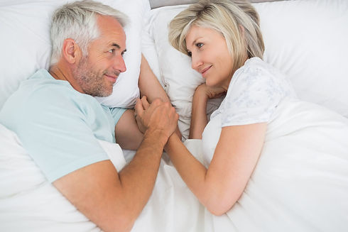 happy-older-couple-in-bed-data.jpg