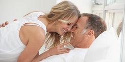 happy 40ish couple in bed.jpg