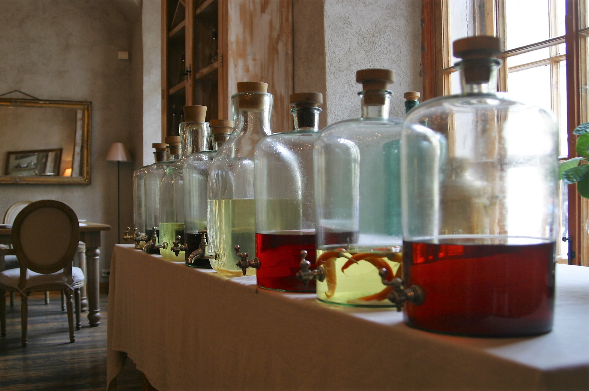 An array of homemade flavored vodkas