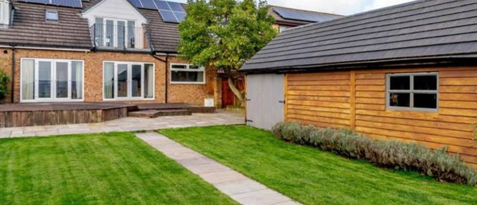 Large modern home rear garden.jpg