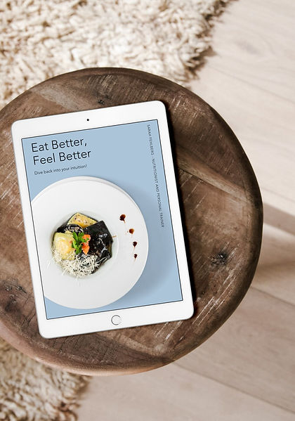 Ipad on wooden stool showing ebook called Eat Better, Feel Better by Sarah Fehlberg