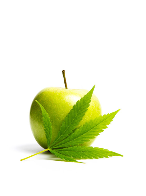 Green apple with marijuana leaf