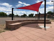 Fabric sail shade & custom seat wall