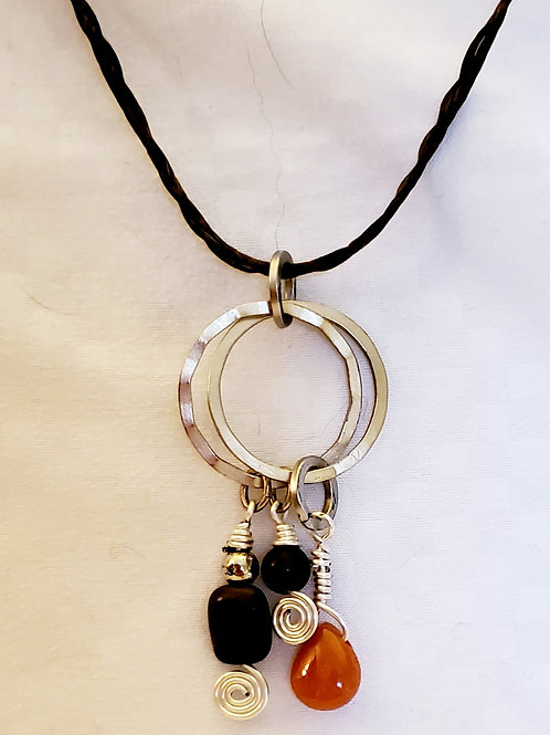 Multimedia double loop pendant on waxed nylon braided cord