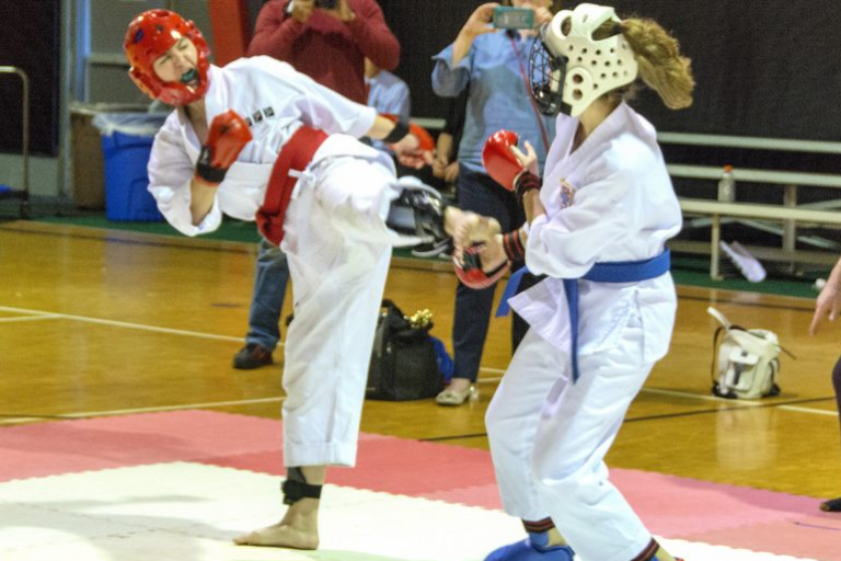 Two women sparring in a competition