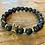 Thumbnail: Unisex Gold Crown Lava Stone Bracelet (energy*uplifting*motivation)