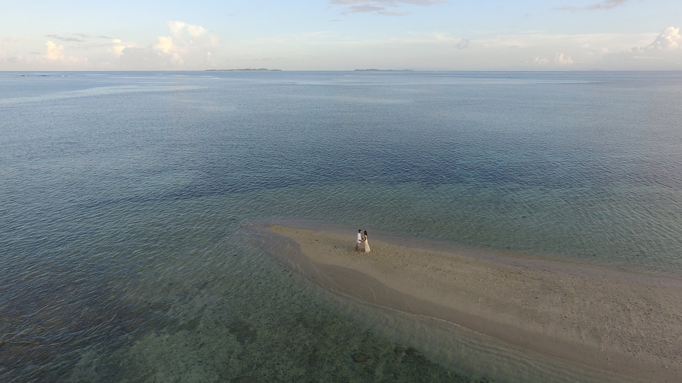 Pansukian, naked, island, blue ocean, sea, panoramic ocean view, wide angle view, white clouds, reef, surrounding island, view, tropical, philippines, shore, waves, couple, photoshoot, engagement, pre-wedding, wedding, photography, siargao, beach wedding