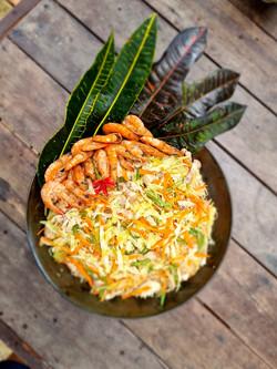 Pancit Bihon and Canton pictured with bright orange shrimps aka hipon