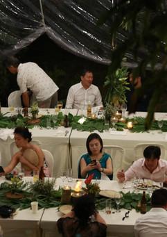 Wedding guests talk at the long tables
