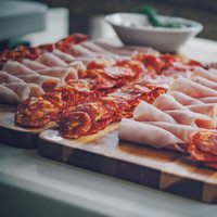 cold cuts to pair with olives and cheese grazing boards at a wedding.jpg