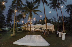 Festive string lights and an open sky right before the wedding dances begin