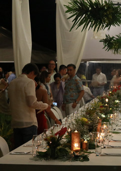 Wedding Guests find their seat amid long tables