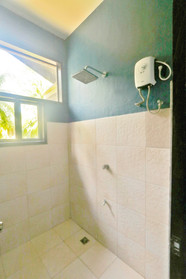 Bunk Room Shower with window to the coconuts