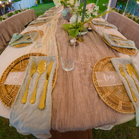 Table setting for the bride and groom at their wedding in Punta Dolores