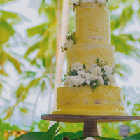 Wedding cake with buttercream frosting and coconuts with flowers