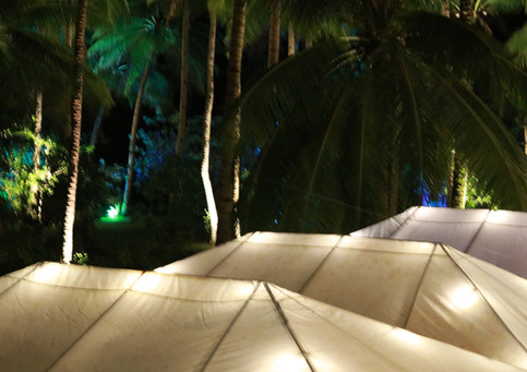 Tents are lit up for the festivities of a Siargao Wedding