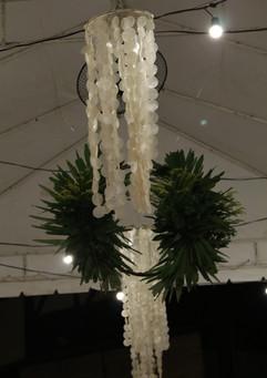 Capiz shell chandeliers and foliage
