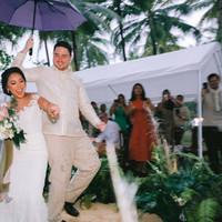 Bride and groom dances together
