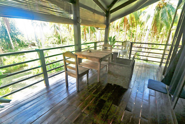 Second floor mezzanine patio with treetop views