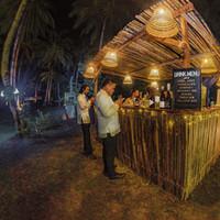 Gentlemen pick up a drink at the Punta Dolores cocktail bar