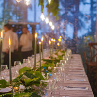 Glowing candles light up a festive wedding