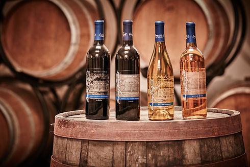 Wine bottles on barrel