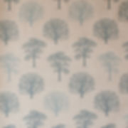 curtain fabric with trees printed on it